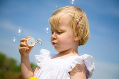 Blow bubbles Royalty Free Stock Photo