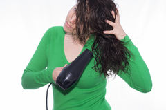 Blow dryer. Girl drying her hair with a blow dryer royalty free stock photography