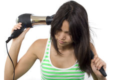 Blow-drying. Teenager dries the hair with a blow-drying Royalty Free Stock Images
