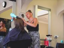 Blow drying hairdresser stock video