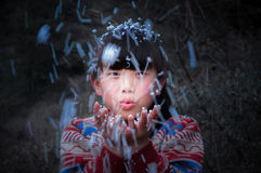 Blow funny asian rural child Royalty Free Stock Images
