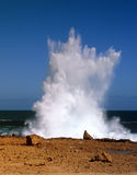 Blow holes insurf. Blow holes in rocks on the ocean shore stock photos