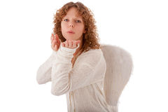 Blow kiss. Angel with white wings Royalty Free Stock Images