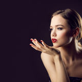 Blow kiss of red lips girl Royalty Free Stock Photography