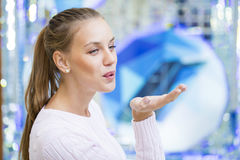 Blow kiss, young caucasian blonde woman. Blow kiss, young caucasian female blonde model, indoor background Royalty Free Stock Photos
