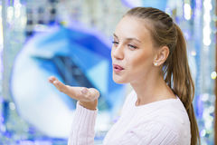 Blow kiss, young caucasian blonde woman Stock Image