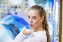 Blow kiss, young caucasian blonde woman. Blow kiss, young caucasian female blonde model, indoor background Stock Photography