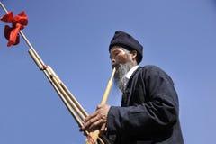 Blow Lusheng, hmong man royalty free stock photo
