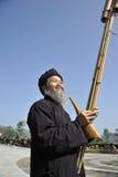 Blow Lusheng,Miao nationality men Royalty Free Stock Image