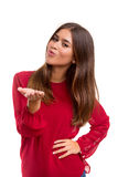 Blow me a kiss!. Beautiful young woman blowing you a kiss, isolated over white Stock Photography