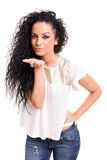 Blow me a kiss!. Beautiful young woman blowing you a kiss, isolated over white Royalty Free Stock Photos