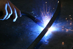 Blow torch. Hand working with blue light Royalty Free Stock Photography