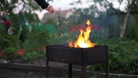 Blow up fire in barbecue stock video footage