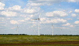 Blow. A wind farm in the wide spread field Royalty Free Stock Image