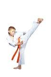 The blow Yoko-geri is doing  athlete on a white background Royalty Free Stock Photos