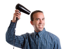 Blowdryer Man. A smiling young man dressed for work and blowdrying his hair, isolated against a white background Royalty Free Stock Image