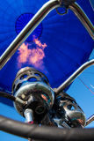 Blower and inside of a blue hot- air balloon Royalty Free Stock Image