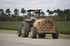 Blower Tractor. Agriculture tractor towing a blower near a field in Miami Florida royalty free stock photography