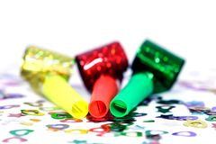 Blowers and confetti. Three blowers and confetti Royalty Free Stock Image
