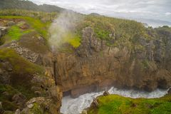 Blowhole Pancake Rocks near Hokatika with stormy weather royalty free stock image