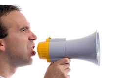 Blowhorn. A profile view of a man yelling into a blowhorn, isolated against a white background Royalty Free Stock Photo