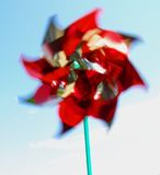 Blowin' in the Wind. Child's pinwheel toy moving in the summer breeze Stock Image