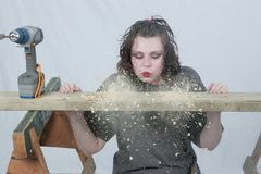 Blowing away the shavings Royalty Free Stock Photography