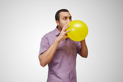 blowing balloon Stock Photos