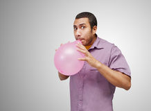 Blowing balloon Royalty Free Stock Photo