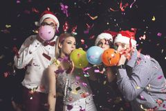 Blowing balloons Stock Images