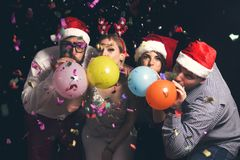 Blowing balloons at New Year`s party stock photos