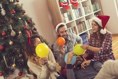 Blowing balloons and preparing for a party Royalty Free Stock Photography
