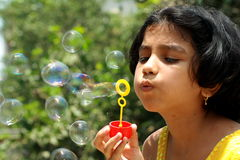 Blowing Beautiful Bubbles Royalty Free Stock Images