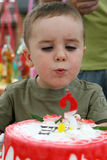 Blowing birthday candles Royalty Free Stock Photo