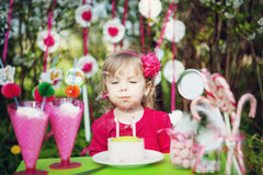 Blowing birthday candles Stock Photos