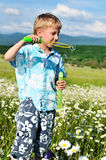 Blowing boy Royalty Free Stock Photo