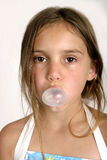 Blowing a bubble. Closeup shot of young girl blowing a bubble with her chewing gum Royalty Free Stock Photography
