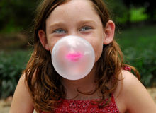 Blowing bubble with gum royalty free stock image