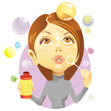 Blowing bubbles. Young female blows colour bubbles Stock Photo