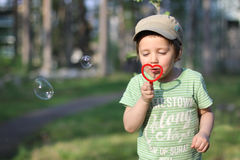 Blowing bubbles Stock Photo