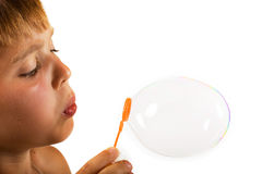 Blowing Bubbles. Boy playing with soap bubbles Royalty Free Stock Images