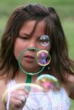 Blowing Bubbles. Little girl blowing bubbles Stock Photo