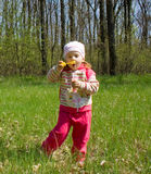 Blowing bubbles. Little child blowing soap bubbles Royalty Free Stock Images