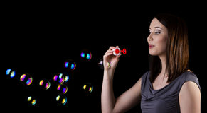 Blowing bubbles Stock Photography