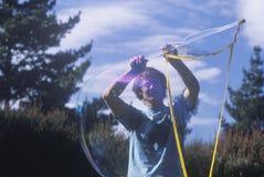Blowing bubbles, Escalon center, Big Sur, CA Stock Photography