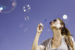 Blowing bubbles ot the sky. Stock Images