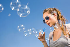 Blowing bubbles ot the sky. Stock Photo