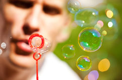 Blowing bubbles outdoor Stock Photo