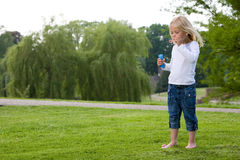 Blowing bubbles in the park Royalty Free Stock Photography