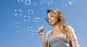 Blowing bubbles into the sky. royalty free stock photo